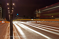 LondonBridge 038 E W (laurencemackman) Tags: lighting longexposure bridge england london cars architecture modern night reflections londonbridge concrete photography lights twilight traffic piers architect historical elevation riverthames span streamline londonskyline theshard motthayandanderson lordholford