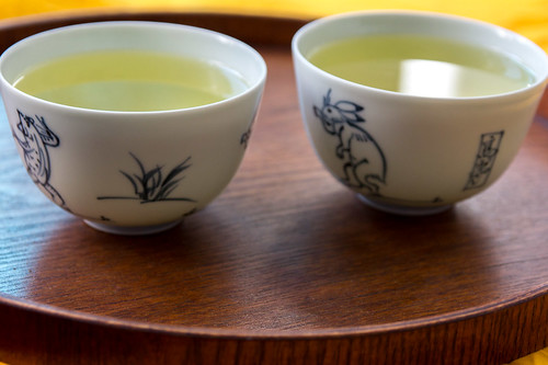 Green Tea in white Tea Cups