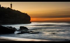 Golden Sky (Atekaba) Tags: ocean longexposure sunset sea sky mer lighthouse france colour beach rock sand nikon raw sable sigma ciel shore 1750 cote plage phare f28 rocher couleur euskadi coucherdesoleil paysbasque atlantique aquitaine poselongue d7100 vision:sunset=0957 vision:beach=0521 vision:outdoor=0864 vision:ocean=0955 vision:clouds=0896 vision:car=0758 vision:sky=0982