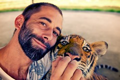 Lunchtime (csigaphoto) Tags: portrait baby smile animal milk bottle colorful tiger lunchtime adventure feed
