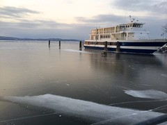 Man, Dog, Ferry on Frozen Lake Champlain (MrRomano) Tags: sunset lake ice burlington canon vermont romano champlain adirondack vt lakechamplain adirondackmountains 802 burlingtonvt burlingtonvermont lawrenceromano joeromano