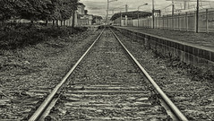 No farewell (AlberBarrera) Tags: love monochrome station train sadness grey vanishingpoint iron loneliness symbol perspective platform railway nobody railwaystation farewell goodbye left solitary hdr leavinghome homesickness