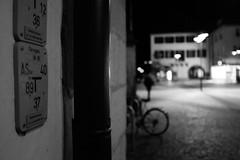 She will come (stefankamert) Tags: she street city light people blackandwhite bw black bike night dark blackwhite lowlight exposure noir fuji noiretblanc availablelight grain sw fujifilm fixed highiso x100 primelens schwarzweis alienskin mirrorless x100s stefankamert