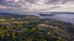 Dusk Lights (Bun Lee) Tags: ocean city morning trees sea urban house canada water beautiful skyline vancouver clouds sunrise buildings landscape dawn coast living downtown day apartments cityscape britishcolumbia cityscapes aerial bowenisland yvr residential westvancouver northburnaby drone lowermainland urbanliving nightskies bunlee dronephotography bunleephotography