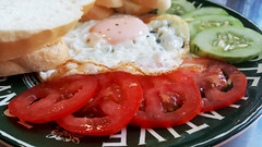 The colours of breakfast (Roving I) Tags: breakfast toast cucumber tomatoes vietnam dining cafes danang friedeggs cabanon
