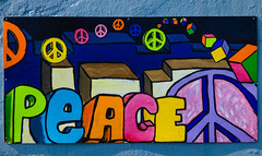 Peace (Steve Taylor (Photography)) Tags: shadow newzealand streetart art texture sunshine wall painting fun happy graffiti cool rainbow peace symbol picture sunny nz southisland colourful greymouth