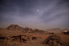 Distant Traveller (Themightyoak) Tags: light mountains night stars sand rocks alone desert 14 atmosphere beam traveller jordan rum 24mm wadi samyang
