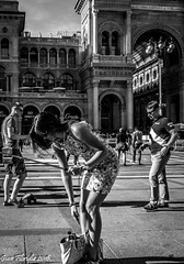 Preparing for a selfie (Gian Floridia) Tags: bw milano streetphotography tourists bn galleria preparation selfie piazzadelduomo bienne
