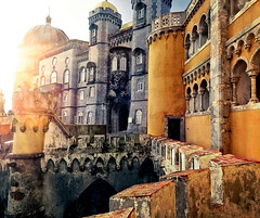 Pena Palace Sundown (Don Csar) Tags: sunset sun sunlight classic sol portugal colors yellow contrast europa europe sintra towers romance amarillo flare pena torres nationalpalace luzdesol