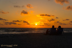 SOFT SAND, WARM BREEZE, GOLDEN SUNSET, GLASS OF WHITE: THEY ARE ENJOYING!! (Wade.J.) Tags: ocean sea vacation sun white beach mexico island golden evening twilight sand couple treasure gulf wine florida dusk sandy sunny tamron2875 wadejanes