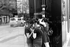 Mirror, mirror (ROSS HONG KONG) Tags: street leica nyc newyorkcity blackandwhite bw monochrome beauty look reflections mirror women noir broadway makeup tourist tourists reflect streetphoto monochrom blanc manhatta