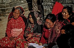 Hindu Nepalese woman offers prayers at Indrayani temple that was damaged in Saturday earthquake, Kathmandu, Nepal. (SUNA_PHOTOGRAPHY) Tags: travel red canon earthquake traditional culture experience hindu journalism