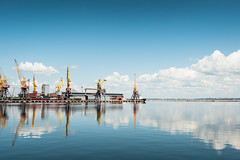 Cranes and reflections (Andrey Baydak) Tags: travel blue sea sky reflection water clouds port docks see crane odessa cranes blau waterscape  2470