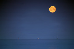 April Full Moon over the Welsh coast (lunaryuna) Tags: sea moon seascape wales night coast ships lunaryuna porttalbot magicnight fullharvestmoon weehoursofthenight lightmood