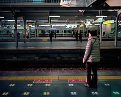 Waiting for the Shinkansen (Evan Tchelepi) Tags: city color building 120 film japan analog train mediumformat kodak platform transit layers 100 6x7 shinkansen depth 80mm ektar 2016 mamiya7
