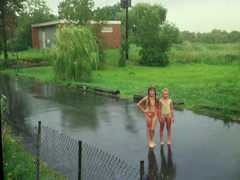 My sister and an L.A. cousin on Rock Street wearing their swimsuits. We used to love going for a swim on rainy, hot summer days. It felt so awesome when heavy rain fell while you were swimming in Long Island Sound. Milford Connecticut. July 1973 (wavz13) Tags: rain barefoot oldphotographs oldphotos analogphotography bikinis kodacolor instamatic bathingsuits oldfamilyphotos vintagephotos oldphotography filmphotography vintagephotographs vintagekids 110film connecticutshoreline vintagephotography vintageteens vintageteenagers 1970sphotos vintagefamilyphotos connecticutphotography teenagememories connecticutphotos 1970sphotographs vintageconnecticut 1970sphotography oldconnecticut oldmilford teenmemories connecticutphotographs oldconnecticutphotography oldconnecticutphotos vintagewoodmont oldwoodmont vintagemilford 1970swoodmont 1970smilford vintagefamilyphotography oldfamilyphotography