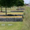 Gabion benches in a row (Terryryan1) Tags: railroadpark tomleaderstudio birmingham alabama bench gabions trees grass edge park