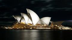 Sydney Opera House at Night (gabrielafundora) Tags: ocean city winter light sea moon white black water night clouds reflections dark outside lights bay wind cloudy sydney australia landmark calm