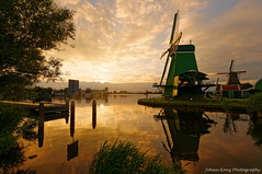 Sunset scene at the Zaan (Johan Konz) Tags: zaanseschans zaandijk netherlands watercourse river dezaan pier windmills sunset orange clouds sky polder kalverpolder outdoor nikon d90 dusk water waterfront degekroondepoelenburg reflections