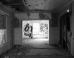 SUR 13 (Myristica) Tags: california wallpaper bw white house black abandoned home broken drywall rooms brokenglass dirty dirt abandonedhouse vandalism and spraypaint walls southerncalifornia peelingpaint filth lightfixture brokenwindow vandalized imperialvalley imperialcounty
