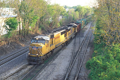 UP Welded Rail Train at Bloomington, IL APR 2012 (CentralILRailfan) Tags: railroad sunset sun up yard speed train evening illinois high fuji pacific union rail railway il transportation electro ready late fujifilm motive passenger normal shovel bloomington division economic hsr freight uprr emd idot stimulus sd70 cpx126