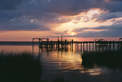 Sunset on the bay (Clayton Kagi) Tags: sunset clouds 35mm f100 nikonf100 35mmfilm outerbanks beachsunset obx thirdstreet fujisuperia800 nikon5018af