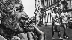 Satisfaction (Rob Castro) Tags: street portrait people blackandwhite panorama man hungary candid budapest trafalgar oldman icecream finepix fujifilm jpeg easterneurope 16x9 artlibres xpro1 juznobsrvr robcastro justanobserver juzno iamgenerationimage 2014robcastro