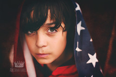 Patriot (Adriana Gomez (Adriana Varela)) Tags: boy usa childhood hope child serious expressions americanflag lookingup greeneyes fourthofjuly patriot independenceday brownhair 11yearold jessicadrossintextures