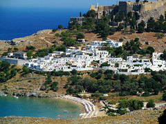 Lindos and its beach (pefkosmad) Tags: houses vacation white holiday beach village greece greekislands rhodes lindos dodecanese rhodes2013