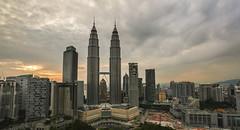 Fierce Sky in Kuala Lumpur (v.pisapati) Tags: from city sunset sky skyline clouds hotel golden photo asia downtown fierce petronas towers taken twin hour malaysia kuala lumpur skybar traders