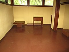 Empty upstairs bedroom/sitting room with Frank Lloyd Wright designed table and desk (ali eminov) Tags: buildings architecture houses rudinhouse architects franklloydwright furniture madison