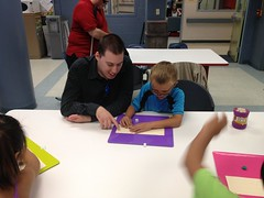 "Volunteer Glenn and BELL participant Jake, play a braille game for reinforcement of good reading skills. • <a style=""font-size:0.8em;"" href=""http://www.flickr.com/photos/29389111@N07/9544494874/"" target=""_blank"">View on Flickr</a>"