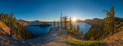 Crater Lake Sunrise (absencesix) Tags: morning travel blue sky panorama orange sun lake mountains green nature colors beauty weather yellow oregon sunrise landscape solitude quiet unitedstates highcontrast bluesky calm noflash september caldera northamerica craterlake daytime brightcolors 24mm portfolio solitary wizardisland locations locale craterlakenationalpark manualmode discoverypoint iso50 timeofday 2013 500px extinctvolcanoes exif:focal_length=24mm geo:state=oregon exif:iso_speed=50 1424mmf28 hasmetastyletag hascameratype naturallocale adjectivesfeelingdescription haslenstype selfrating3stars camera:make=nikoncorporation afsnikkor1424mmf28g 180secatf11 exif:make=nikoncorporation geo:countrys=unitedstates exif:lens=140240mmf28 exif:aperture=ƒ11 subjectdistanceunknown nikond800e exif:model=nikond800e camera:model=nikond800e 2013travel september42013 craterlake0902201309062013 geo:city=craterlakenationalpark craterlakenationalparkoregonunitedstates geo:lat=42920296 geo:lon=122162019 42°5513n122°943w