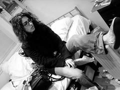 Wet feet (Gary Kinsman) Tags: bw woman london wet pose blackwhite persian availablelight ambientlight candid 2006 iranian kensington unposed radiator drying w8 wetfeet princeofwalesterrace