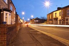 Deacon Road light trails (Barry Miller _ Bazz) Tags: road england nightshot cheshire streetlamps brickwall gb lighttrails footpath yellowlines widnes halton deaconroad