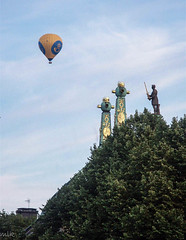 Balloons. Looking south at the Gamla stan. Stockholm 2002 (Tiigra) Tags: 2002 stockholm city column funorinterest sculpture shape spire statue stockholmcounty sweden art