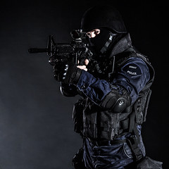 SWAT officer (getmilitaryphotos) Tags: black soldier fight team gun force mask action background military helmet police security assault special equipment colorized armor weapon terrorism law enforcement vest squad toned anti protection tactics officer lawenforcement swat weapons forces firearms armed specialforces swatteam filtered warfare tactical antiterrorism antiterror counterterrorist counterterrorism
