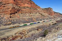 Stack in Echo Canyon (Moffat Road) Tags: railroad up train utah ut echo cliffs unionpacific redrock echocanyon emd doublestack sd70m stacktrain intermodaltrain