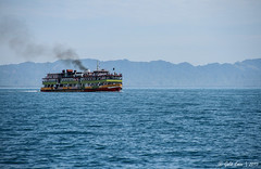 The Bay of Bengal (Galib Emon) Tags: ocean travel blue copyright water beautiful weather canon wonderful landscape eos boat is ship outdoor smoke hills 7d vehicle bangladesh bazar coxs chittagong bluesea emon f3556 teknaf galib thebayofbengal efs18135mm