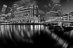 West India Quay, Docklands, London (david gutierrez [ www.davidgutierrez.co.uk ]) Tags: city uk longexposure bridge urban blackandwhite london art monochrome architecture night skyscraper photography cityscape photographer fisheye londres floatingbridge westindiaquay londonphotographer davidgutierrezphotography pentaxk5 pentaxsmcda1017mmf3545ediffisheye