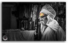 Portrait of a holy man on a pilgrimage to the holy Pushak Lake! (KS Photography!) Tags: street travel portrait blackandwhite bw india lake black senior face saint closeup dreadlocks beard blessings religious temple person photography photo blackwhite nikon focus looking adult indian traditional religion culture streetphotography depthoffield holy human yogi facialhair meditation karma turban mustache nikkor forehead spiritual pushkar hindu hinduism wrinkles nikondigital pilgrimage baba cultural rajasthan sadhu brahma guru ajmer ethnicity holyman selectivecolor brahmin travelphotography greay tilak saadhu gyani streetsofrajasthan photoborder 35mmf18g |rajasthan pushkarsarovar