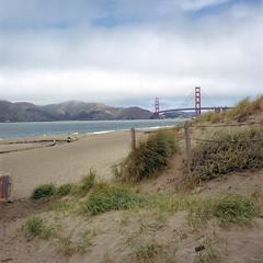 The Fence and The Gate (Scott Holcomb) Tags: sanfrancisco california 6x6 mediumformat 120film goldengate bakerbeach zenzabronicas2 kodakportra400film epsonperfectionv600 photoshopdigitalization kowal393cuv67filter nikkorp14f200mmlens