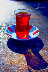 Trk ay (haidarism (Ahmed Alhaidari)) Tags: tea turkishtea tourist tourism travel trk ay trkay hospitaltiy tulipshaped glass free meal culture light shadow depthoffield sonya65 macro macrophotography reflection