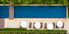 (elzauer) Tags: blue brazil latinamerica horizontal outdoors photography deckchair br sopaulo nopeople sunshade swimmingpool sampa poolside distant loungechair watersurface beachumbrella colorimage sopaulostate highangleview