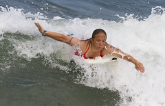 Paddling through the wave (San Diego Shooter) Tags: surfer surfing sandiego pacificbeach surfergirl girl