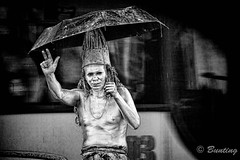 A mime stands under an umbrella during a torrential rain in Bogota (stevebfotos) Tags: bogota infrared adfc bw rain mime topaz bogot colombia co