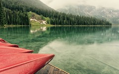 Cast out doubt (Tracey Rennie) Tags: red mist mountain lake green rain clouds bc britishcolumbia canoes emeraldlake yohonationalpark