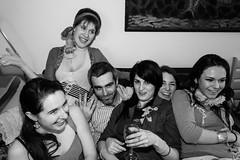 Getting comfortable (Gary Kinsman) Tags: london canon5d canon28mmf18 canonspeedlite430exmkii houseparty party fun crazy 2011 holborn wc1 bw blackwhite candid unposed flash slowsyncflash slowsync group sofa comfortable
