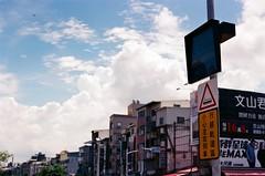 traffic light (popo kuo) Tags: sky cloud film canon outdoor taiwan kaohsiung fujifilm   lrt 50mmf18 lightrailtransit xtra400  eos7