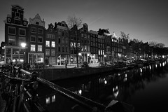 Singel Centrum (McQuaide Photography) Tags: old city longexposure nightphotography bridge light blackandwhite bw house holland reflection building history water netherlands monochrome dutch amsterdam architecture night zeiss outside mono licht canal blackwhite europe nacht outdoor sony traditional tripod nederland wideangle oldbuildings historic brug fullframe alpha huis singel 16mm residential oud stad authentic manfrotto noordholland gebouw gracht c1 huizen canalhouse wideanglelens 1635mm northholland grachtenpand groothoek phaseone variotessar captureone mirrorless sonyzeiss mcquaidephotography a7rii ilce7rm2 captureonepro9